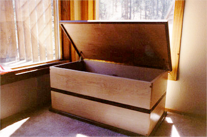 walnut and maple blanket box doubles as a sitting banco
