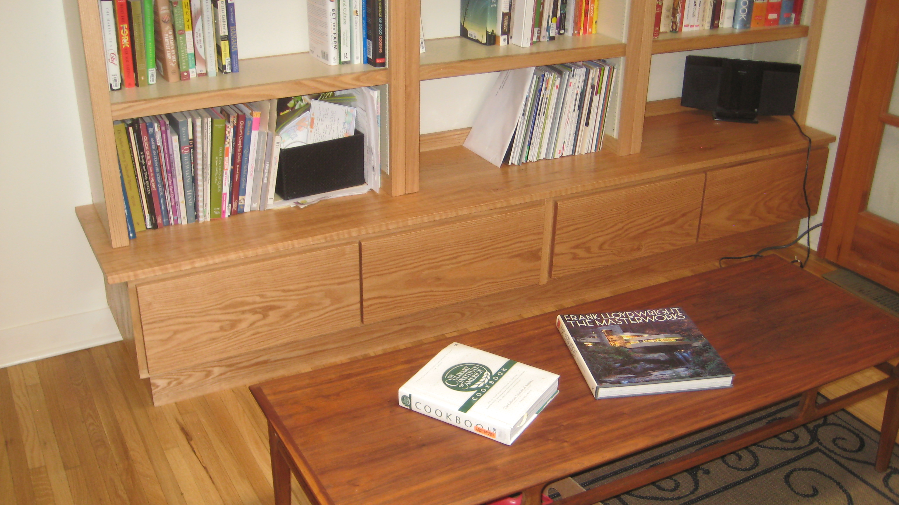 Oak bookshelf with lower drawers