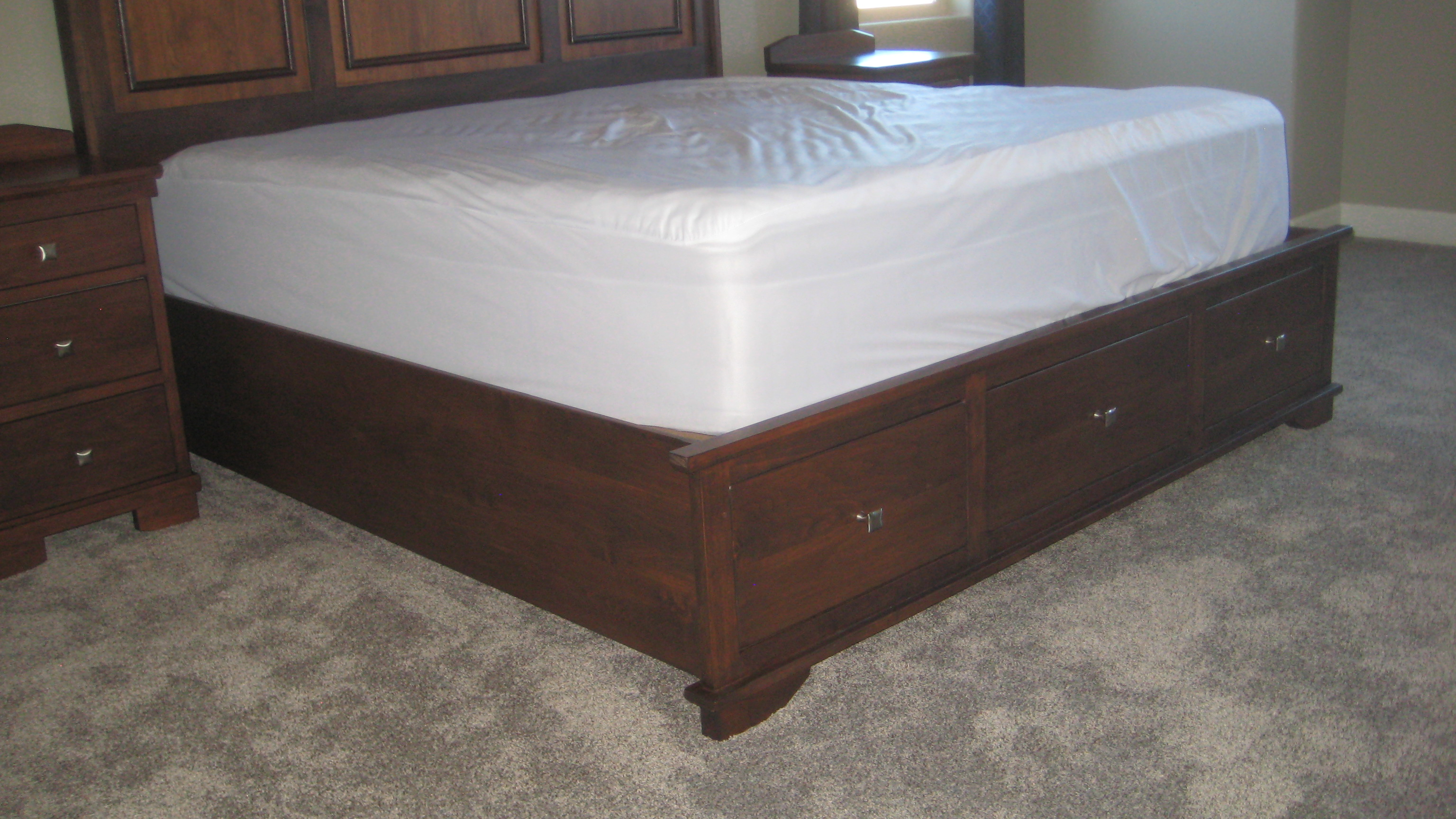 pedestal bed in Alder with drawers